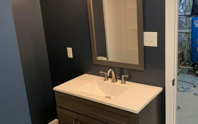 sink, mirror and plumbing