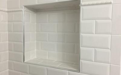 Shower tile shelf