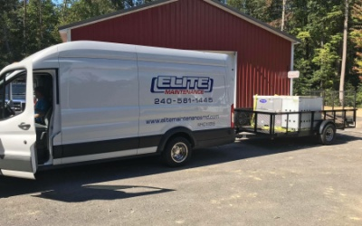 elite maintenance truck and trailer carrying rooftop unit