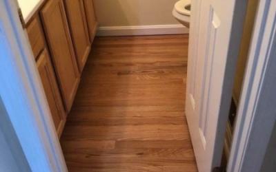 Wood floor installation in bathroom