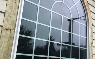 New arch window installation